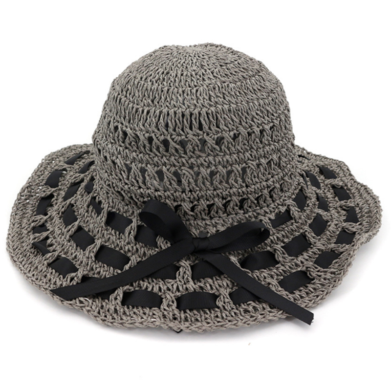 Female's summer crochet paper hat with ribbon weave into the brim